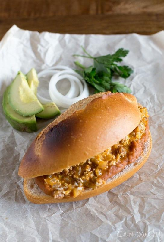Mexican Torta With Eggs Chorizo And Frijoles