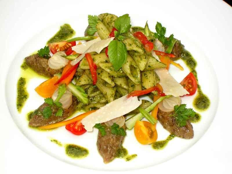 Penne Pasta With Pesto Sauce And Sausages